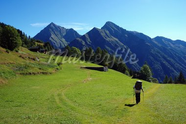 Trekker walking along a mountain path, west Alps, Italy. Stock Photo - Royalty-Free, Artist: rcaucino, Code: 400-03939012