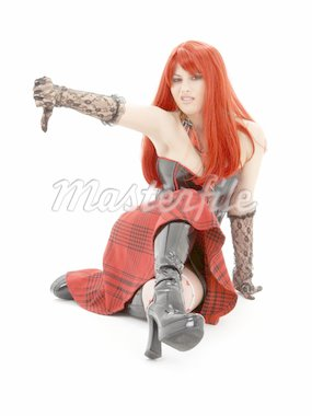 aggressive schoolgirl in black latex boots showing thumbs down Stock Photo - Royalty-Free, Artist: dolgachov, Code: 400-03939994