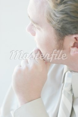 Close up of one business man with hand on chin looking away Stock Photo - Royalty-Free, Artist: bellemedia, Code: 400-03940268