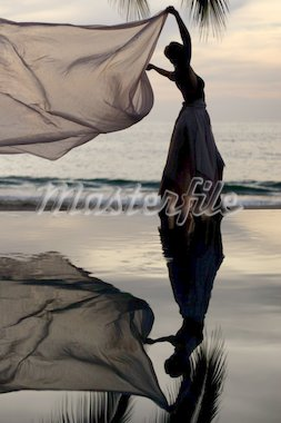 Woman with a scarf and her reflection in a pool by the ocean Stock Photo - Royalty-Free, Artist: barsik, Code: 400-03945214