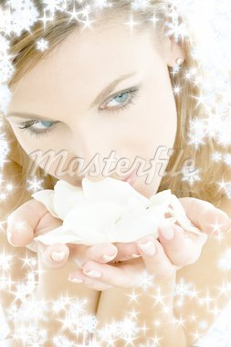 lovely woman in christmas spa smelling white rose petals Stock Photo - Royalty-Free, Artist: dolgachov, Code: 400-03948111