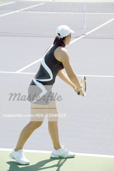 Woman serving the ball at the professional tennis tournament Stock Photo - Royalty-Free, Artist: barsik, Code: 400-03948114