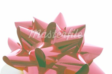 ribbon on a gift box isolated over white Stock Photo - Royalty-Free, Artist: leafy, Code: 400-03951602