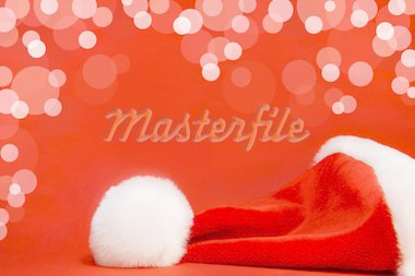 Red santa hat against a red background Stock Photo - Royalty-Free, Artist: Sandralise, Code: 400-03951628