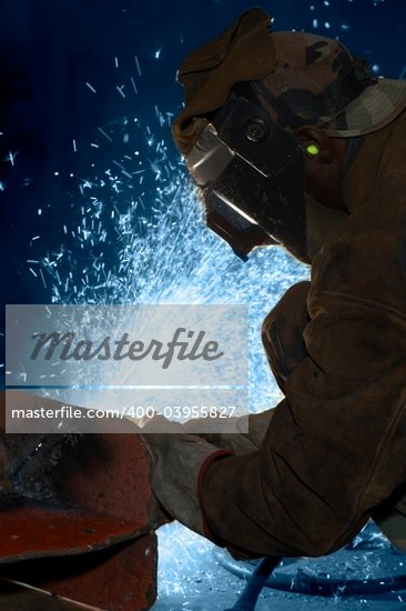 an arc welder spraying a lot of fire Stock Photo - Royalty-Free, Artist: glenj, Code: 400-03955827