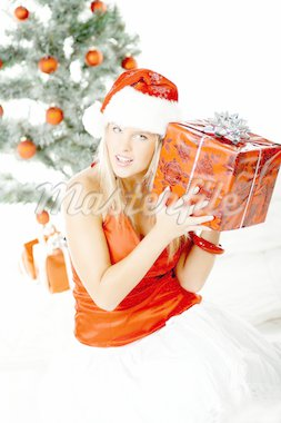 Beautiful young woman next to christmas tree wearing santas hat on white background Stock Photo - Royalty-Free, Artist: dash, Code: 400-03960028