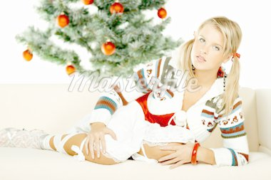 Beautiful young woman next to christmas tree on white background Stock Photo - Royalty-Free, Artist: dash, Code: 400-03960085