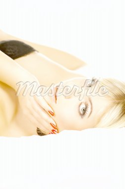 Portrait of attractive beautiful young woman on bed Stock Photo - Royalty-Free, Artist: dash, Code: 400-03960221