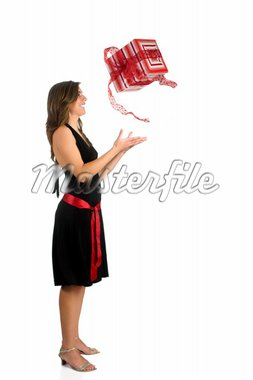 Happy woman isolated on a white background sending a the present to the air Stock Photo - Royalty-Free, Artist: iko, Code: 400-03960881