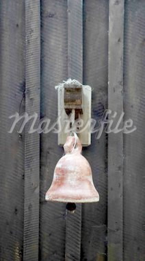 Old metal bell hanging on a black wall. Stock Photo - Royalty-Free, Artist: ginaellen, Code: 400-03961184