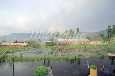 Houseboats in Srinigar, Kashmir (India) - after a light rain a rainbow appears in the distance with mountains as the backdrop. Stock Photo - Royalty-Free, Artist: sumners, Code: 400-03964683