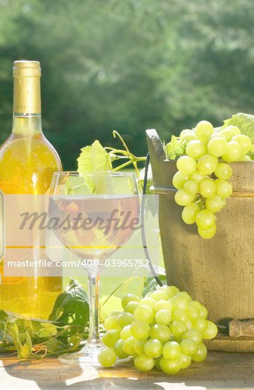 White wine with bottle and grapes on a rustic table Stock Photo - Royalty-Free, Artist: Sandralise, Code: 400-03965752