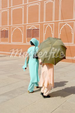 Traditional dressed Indian women walking through the Red Palace Stock Photo - Royalty-Free, Artist: mschalke, Code: 400-03965771