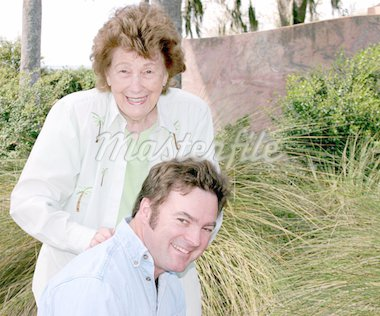 A mother giving her adult son a shoulder massage in the park. Copyspace for text. Stock Photo - Royalty-Free, Artist: lisafx, Code: 400-03969257