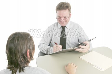 A friendly guidance counselor talking to a teen. Stock Photo - Royalty-Free, Artist: lisafx, Code: 400-03970460