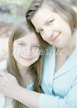 A loving portrait of a beautiful mother and daughter. Focus on the daughter. Stock Photo - Royalty-Free, Artist: lisafx, Code: 400-03970497