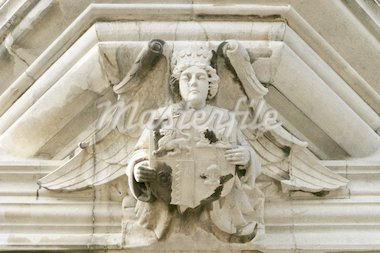 An architectural detail with an angel showing a family crest. This sculpture was located over the main door of an old mansion in the Irish countryside. Stock Photo - Royalty-Free, Artist: searagen, Code: 400-03984568