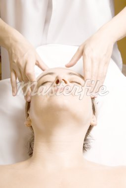 woman relaxing with a nice facial massage Stock Photo - Royalty-Free, Artist: yanc, Code: 400-04005178