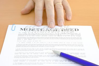 Male hand presents a mortgage document Stock Photo - Royalty-Free, Artist: Marlee, Code: 400-04005644