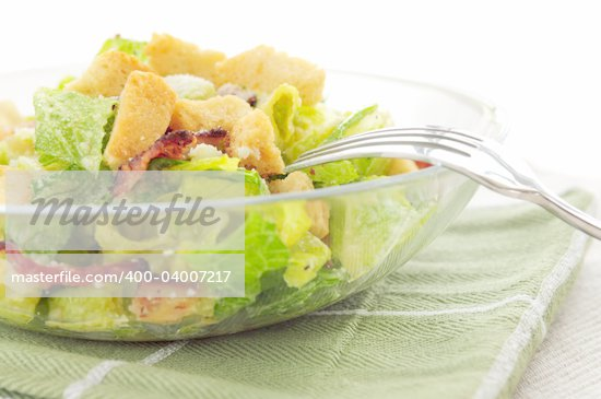 Fresh caesar salad with croutons and bacon bits served in a glass bowl Stock Photo - Royalty-Free, Artist: Elenathewise, Code: 400-04007217