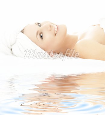 picture of happy lady relaxing on white sand Stock Photo - Royalty-Free, Artist: dolgachov, Code: 400-04016355