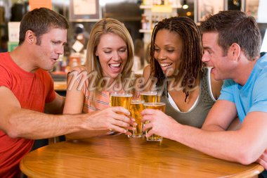 Group Of Friends In Bar Drinking Beer Stock Photo - Royalty-Free, Artist: MonkeyBusinessImages, Code: 400-04016891