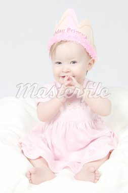 Little Baby Girl in Pink dress and birthday hat and hands together Stock Photo - Royalty-Free, Artist: melking, Code: 400-04020121