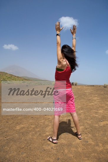 woman catching a cloud with the teide volcano at the background Stock Photo - Royalty-Free, Artist: quintanilla, Code: 400-04029169
