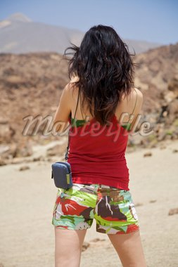 woman backwards with the teide volcano at the top Stock Photo - Royalty-Free, Artist: quintanilla, Code: 400-04029170