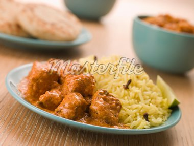 Plated Chicken Korma with Pilau Rice and Naan bread Stock Photo - Royalty-Free, Artist: MonkeyBusinessImages, Code: 400-04034130