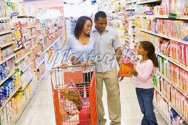 Young family grocery shopping in supermarket Stock Photo - Royalty-Free, Artist: MonkeyBusinessImages, Code: 400-04036057