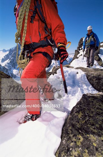 Young men mountain climbing on snowy peak Stock Photo - Royalty-Free, Artist: MonkeyBusinessImages, Code: 400-04036393