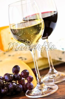 Wineglasses with red and white wine and assorted cheeses Stock Photo - Royalty-Free, Artist: Elenathewise, Code: 400-04040062