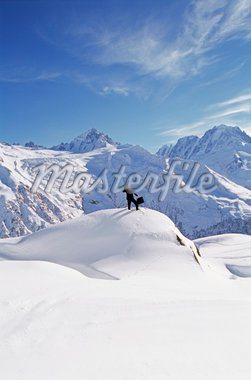 Businessman outdoors on snowy mountain using cellular phone Stock Photo - Royalty-Free, Artist: MonkeyBusinessImages, Code: 400-04041667
