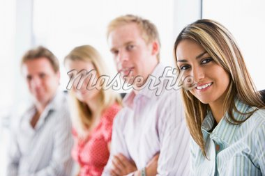 Four businesspeople sitting indoors smiling Stock Photo - Royalty-Free, Artist: MonkeyBusinessImages, Code: 400-04042020