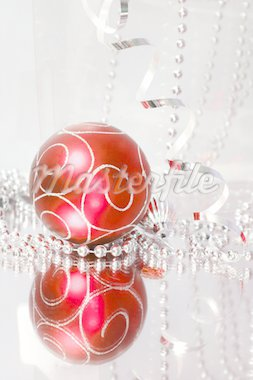 A lovely red baubles on a mirror  surface with ribbons and beads. Stock Photo - Royalty-Free, Artist: sundikova, Code: 400-04054329