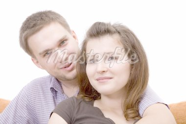 casual couple sitting on sofa Stock Photo - Royalty-Free, Artist: netris, Code: 400-04056750