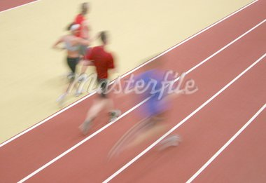 Motion blurred athletes competing on the track Stock Photo - Royalty-Free, Artist: klikk, Code: 400-04064304