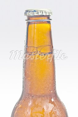 Bottle of beer resting on a bed of ice Stock Photo - Royalty-Free, Artist: DTPhoto, Code: 400-04065497
