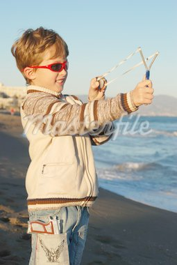 The boy plays on a beach Stock Photo - Royalty-Free, Artist: Vallog, Code: 400-04067159