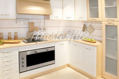 Modern wooden kitchen counter with big cabinet  Stock Photo - Royalty-Free, Artist: Baloncici, Code: 400-04069529