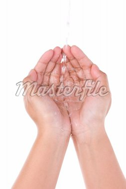 A hand trying to store the fresh water in both palm close each other, shot against very bright white screen. Intentionally didn't drag up the shutter speed to catch the blur movement of the water Stock Photo - Royalty-Free, Artist: OtnaYdur, Code: 400-04082703