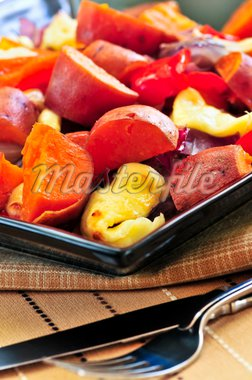 Vegetarian dish of roasted yams with cheese and peppers Stock Photo - Royalty-Free, Artist: Elenathewise, Code: 400-04083842