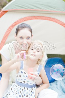 Young mother and daughter together in tent Stock Photo - Royalty-Free, Artist: 4774344sean, Code: 400-04114615