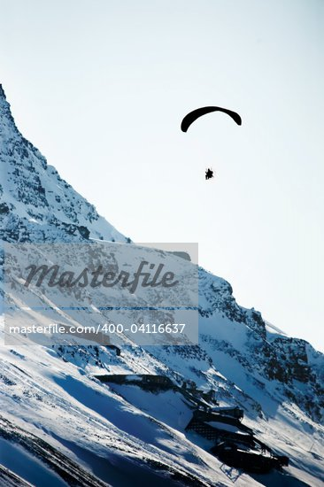 A paraglider travelling over a rocky mountain Stock Photo - Royalty-Free, Artist: Leaf, Code: 400-04116637