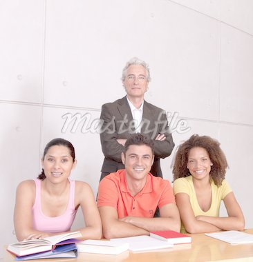 Group of happy students studying with lecturer Stock Photo - Royalty-Free, Artist: carlosseller, Code: 400-04117620