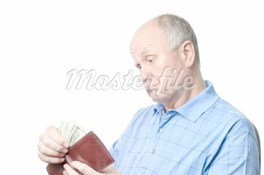 dissatisfied senior bald man is examining his cash savings Stock Photo - Royalty-Free, Artist: starush, Code: 400-04125710