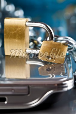 Padlock and notebook computer Stock Photo - Royalty-Free, Artist: JanPietruszka, Code: 400-04126842