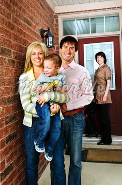 Real estate agent with family welcoming to new home Stock Photo - Royalty-Free, Artist: Elenathewise                  , Code: 400-04133262