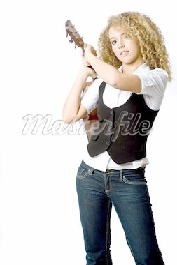 An attractive young teenage woman with an acoustic guitar on white background Stock Photo - Royalty-Free, Artist: eastwestimaging               , Code: 400-04142985